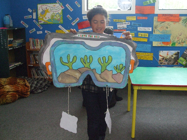 Caption: Puna Whakaata show casing her amazing artwork.